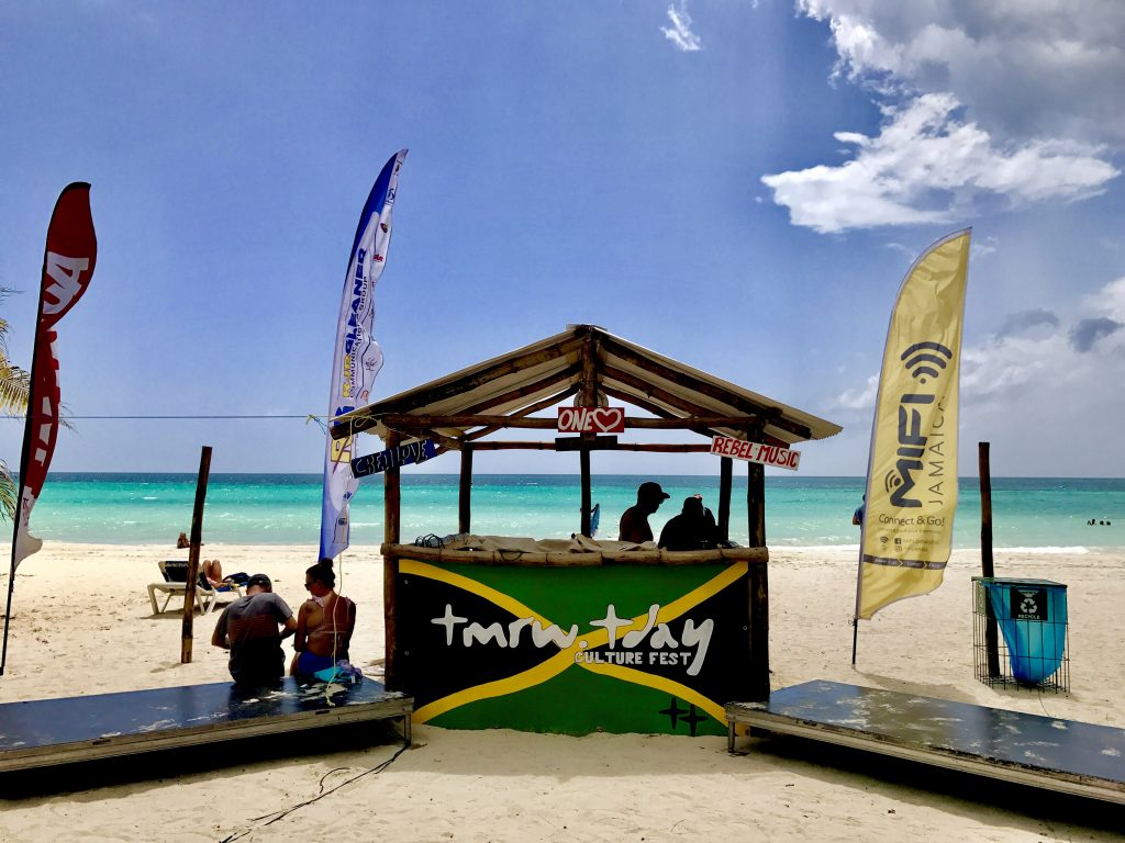 Culture Festival in Jamaica | TMRW.TDAY | Beachside Music Venue (Photo Description: Stage facing towards the land and the photo is taken looking straight at the stage towards the ocean horizon | Seven Mile Beach | Photo Credit: Michael Morahan